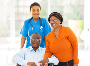 nurse and elderly man smiling