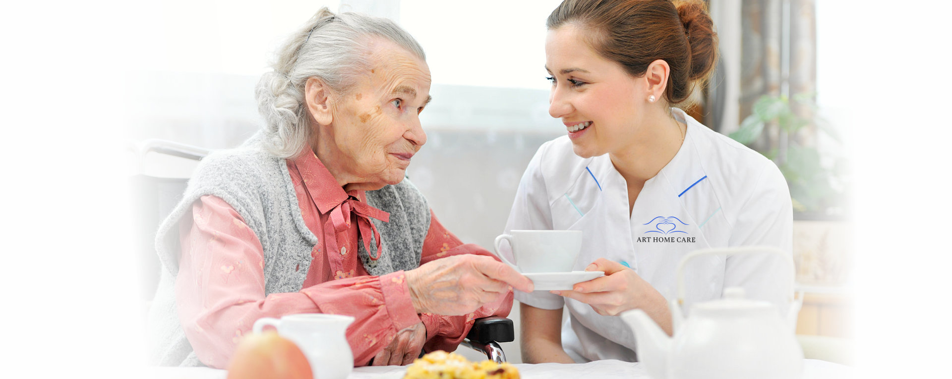 nurse serving soup to an elderly woman