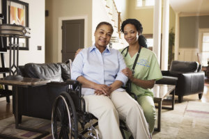 caregiver with wheelchaired person